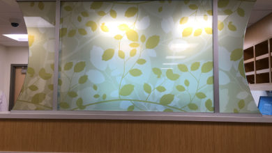 custom printed glass privacy screen for healthcare facility