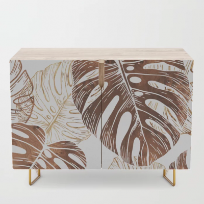 monstera in wood credenza
