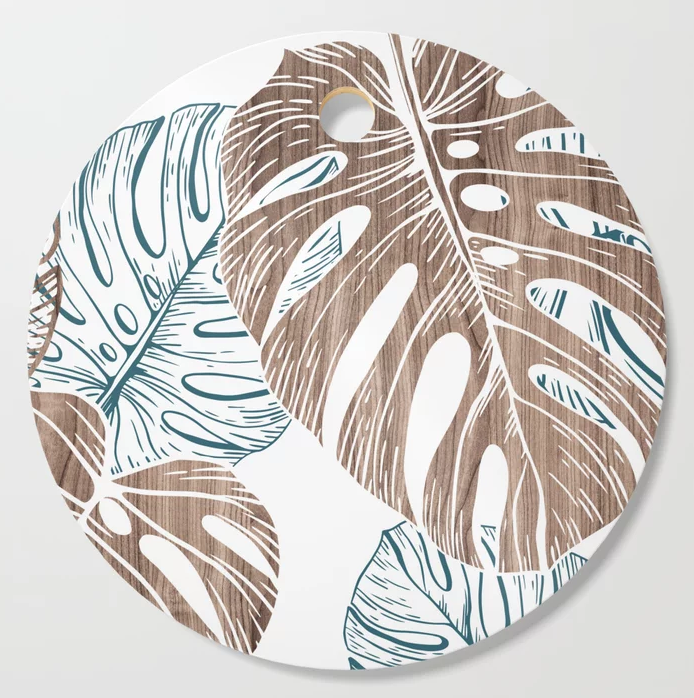 monstera in wood cutting board